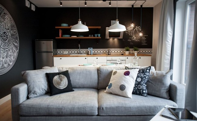 Plush-gray-couch-in-the-living-room-with-black-walls